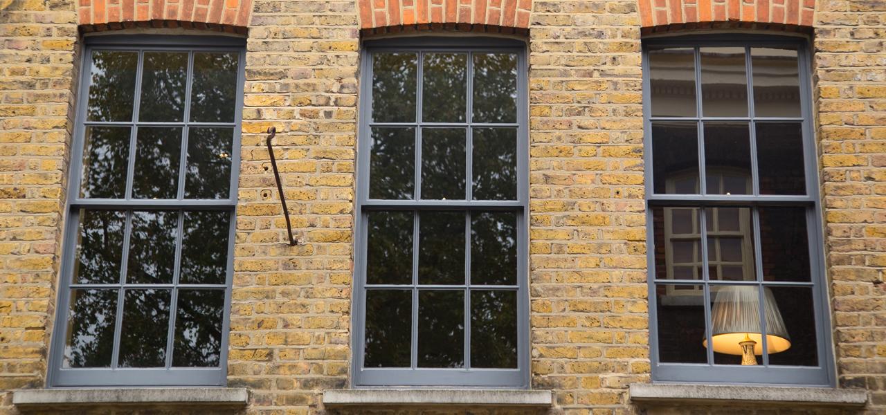 Building exterior with sash window